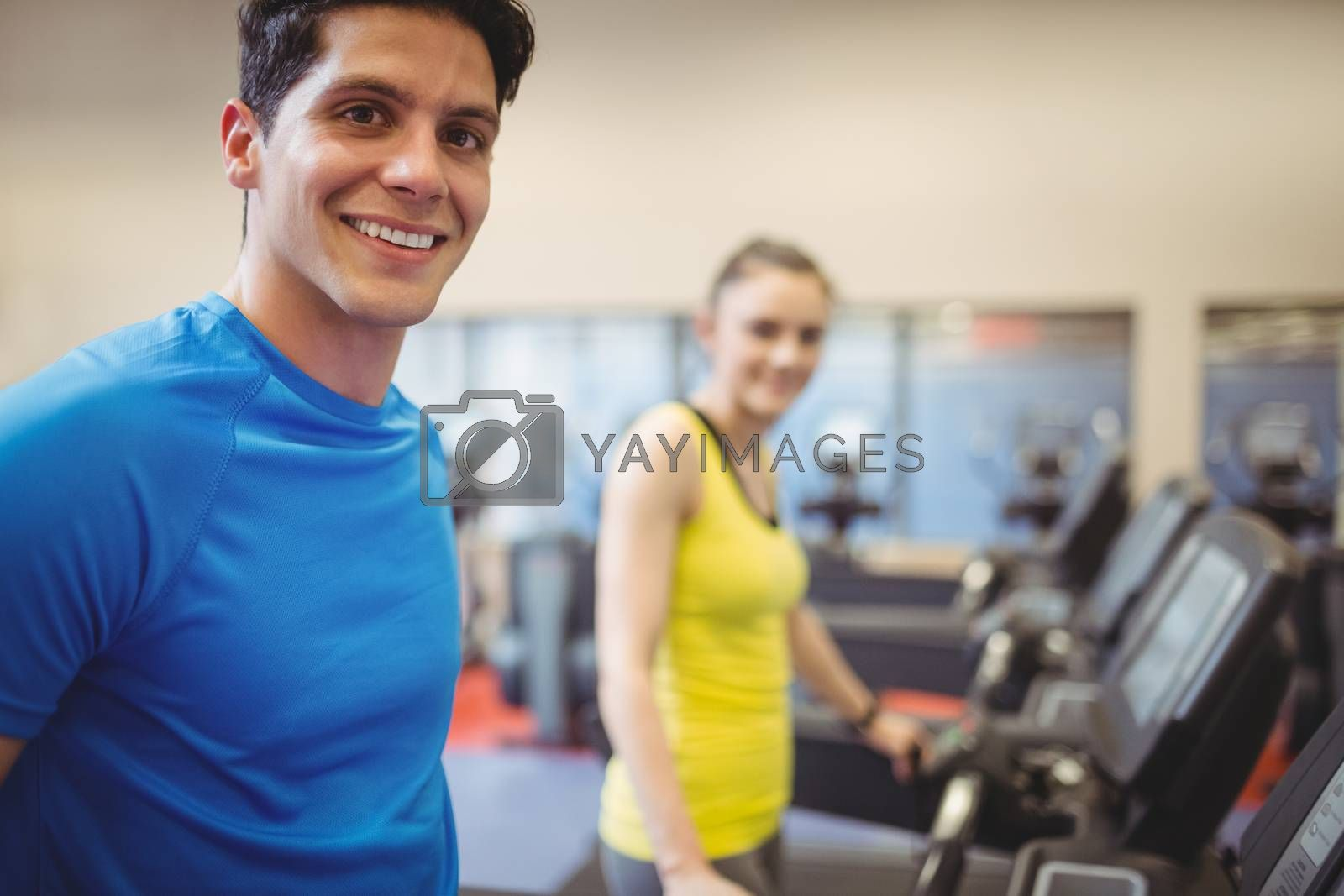 Fit people using the treadmill at the gym