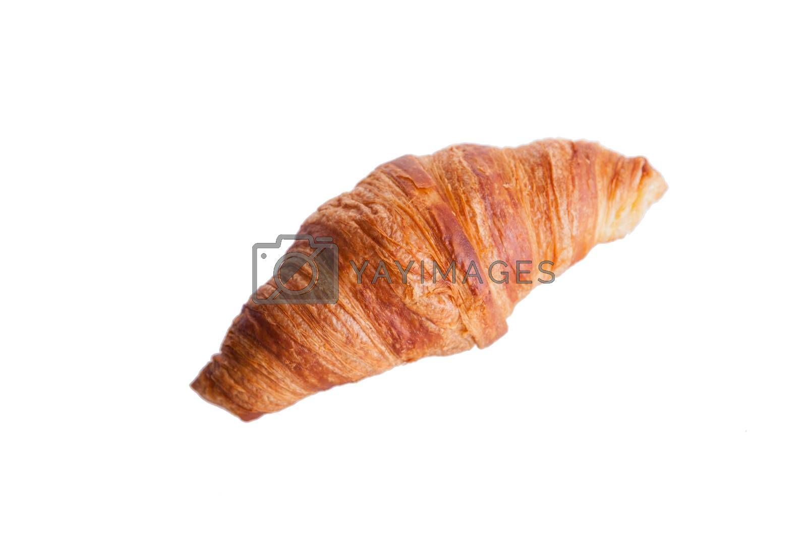 Fresh and tasty croissant over white background. Golden crust.