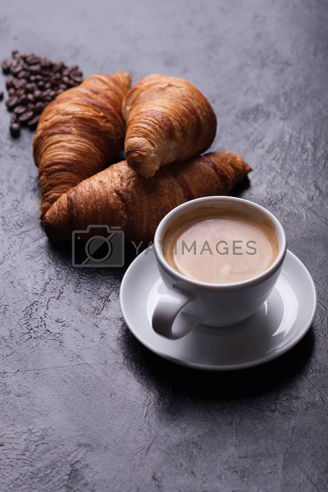 Breakfast with freshly baked croissants and cup of coffee by DCStudio