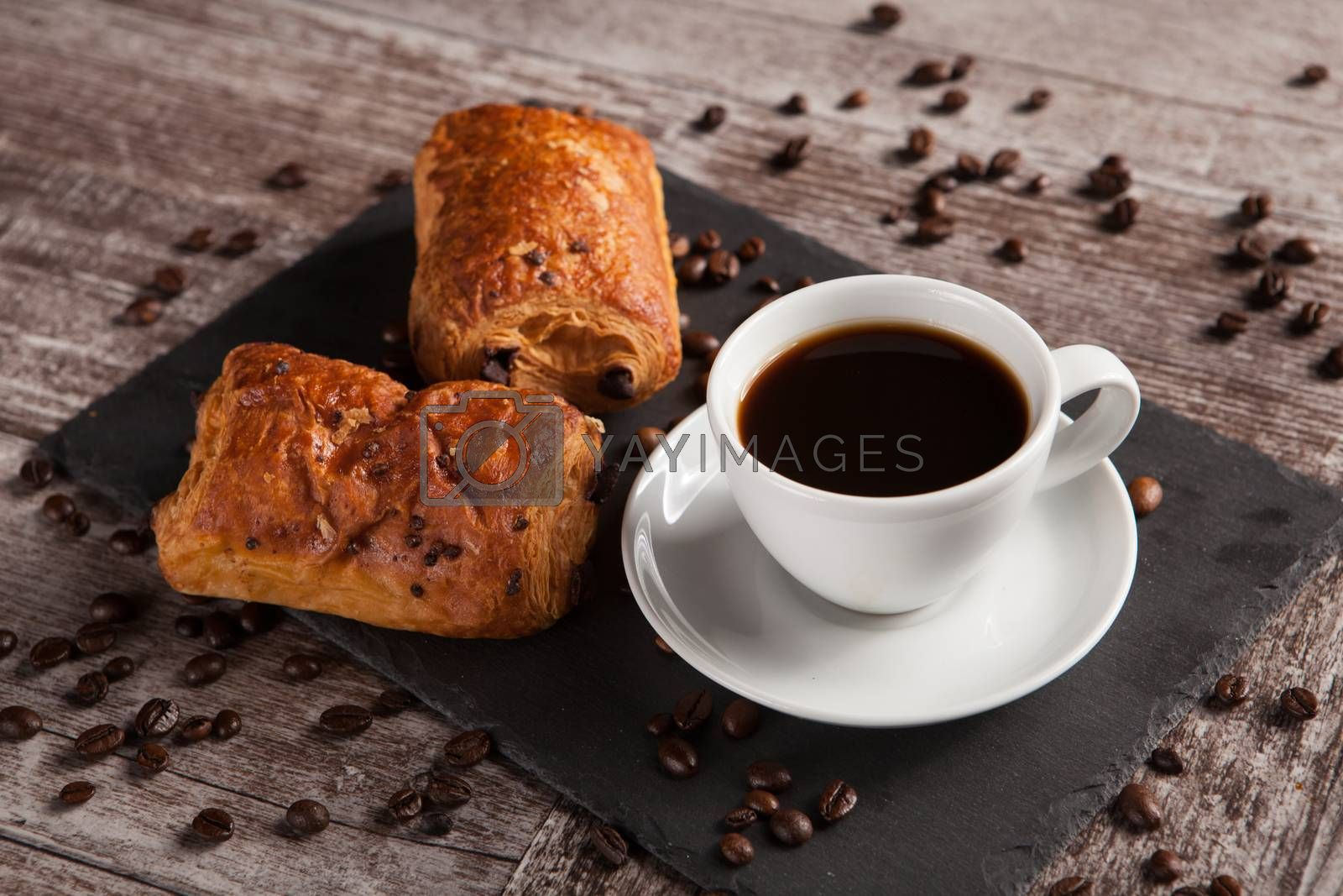 Sweet Croissants with almonds, hot coffee and spreaded coffee be by DCStudio