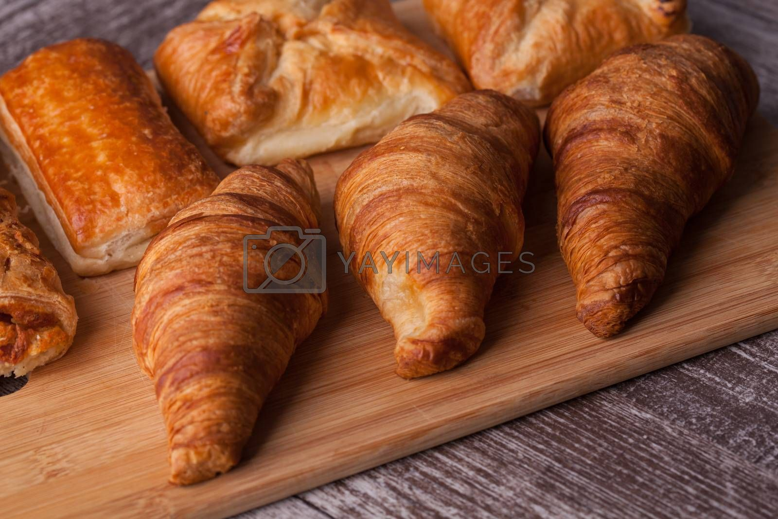 Assortment of french pastries on cutting board. Delicious Brunch.