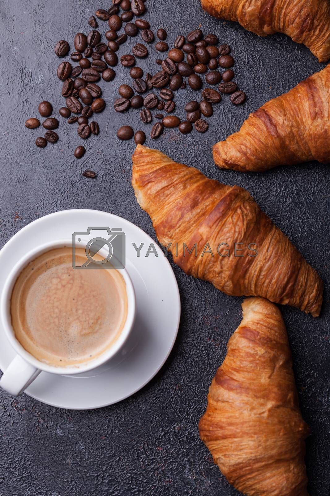 Top view of coffee and croissant with coffee beans by DCStudio