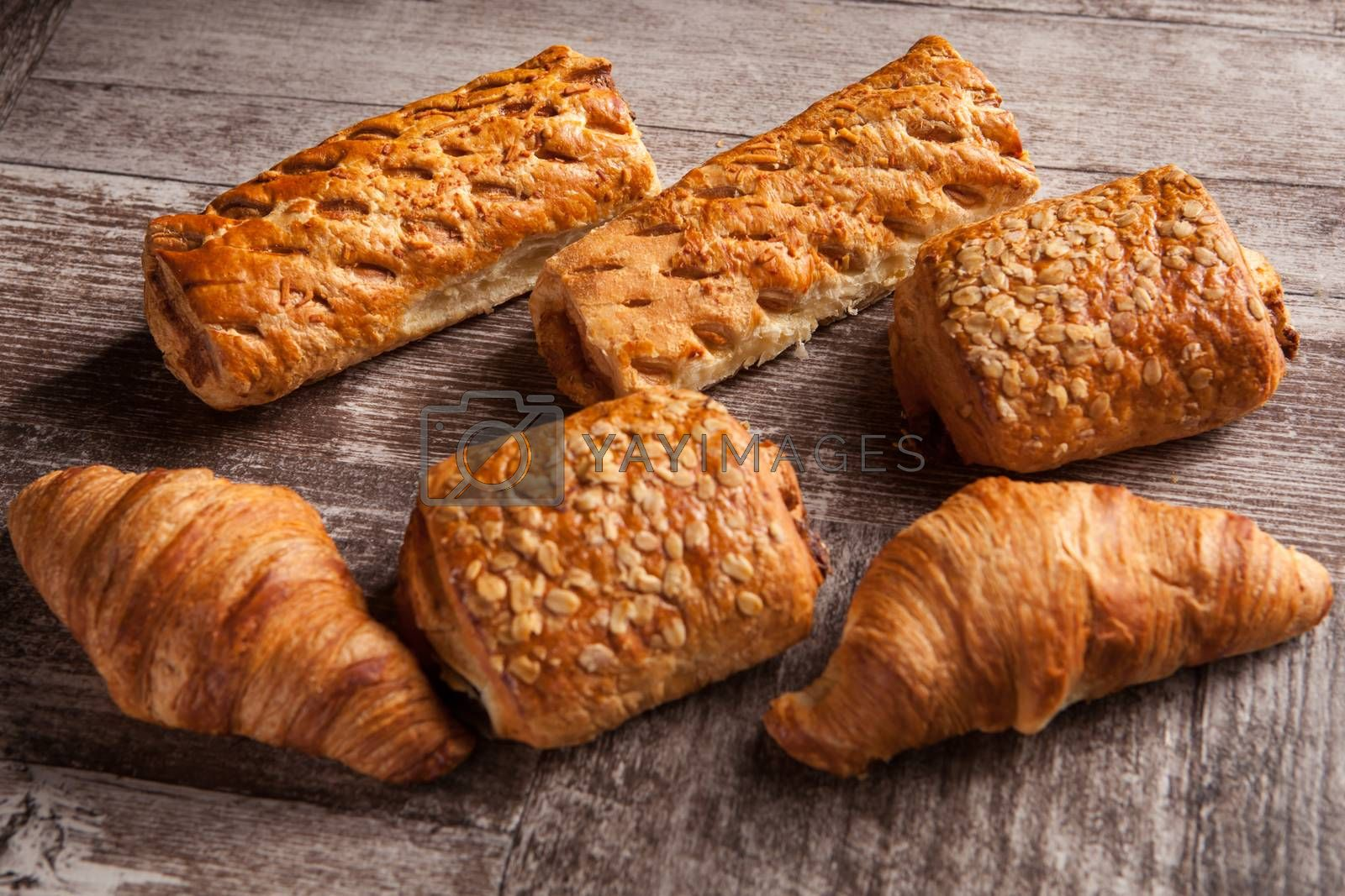 Assortment of pastries on rustic wooden table. Delicious brunch.