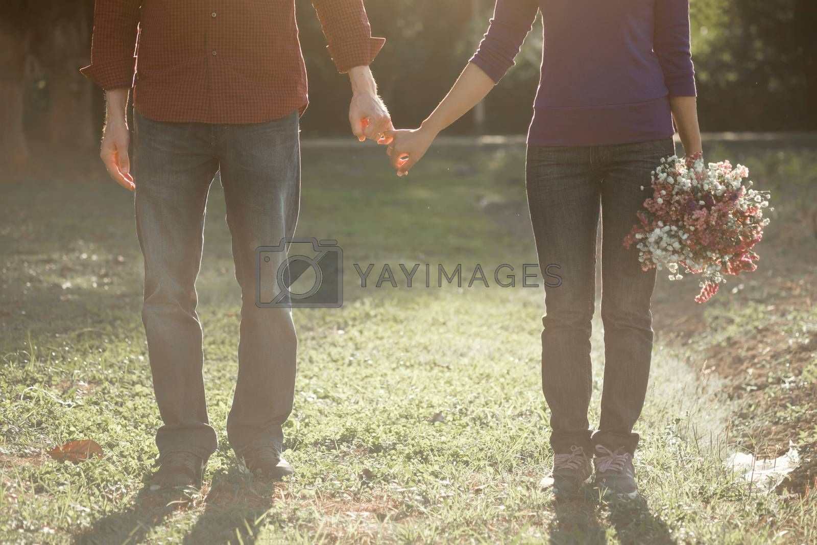 Happy couple holding hands together as forever love.  by ijeab