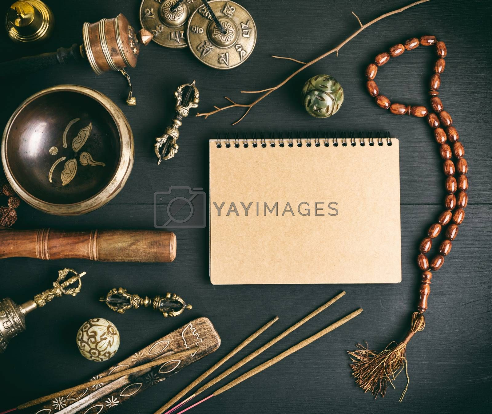 Asian religious musical instruments for meditation and notebook  by ndanko