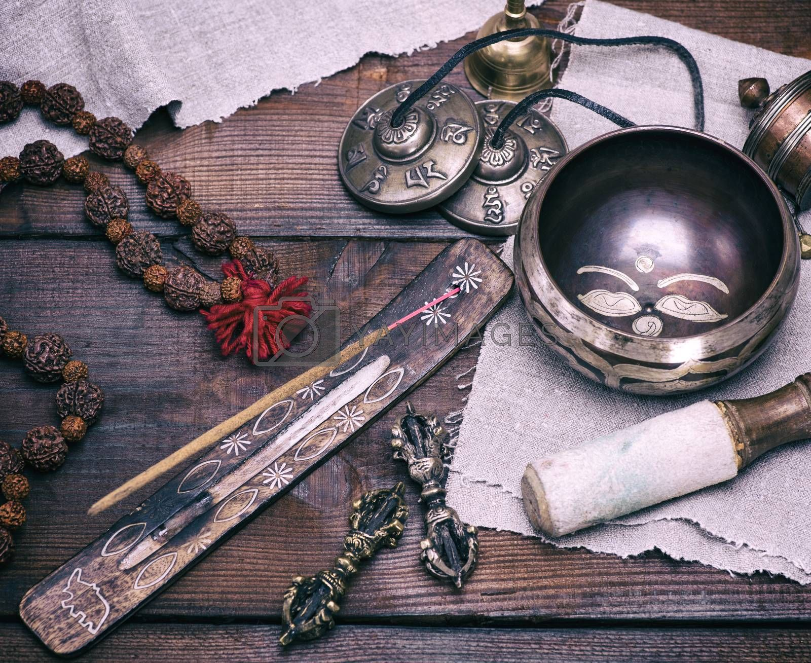copper singing bowl and incense stick by ndanko