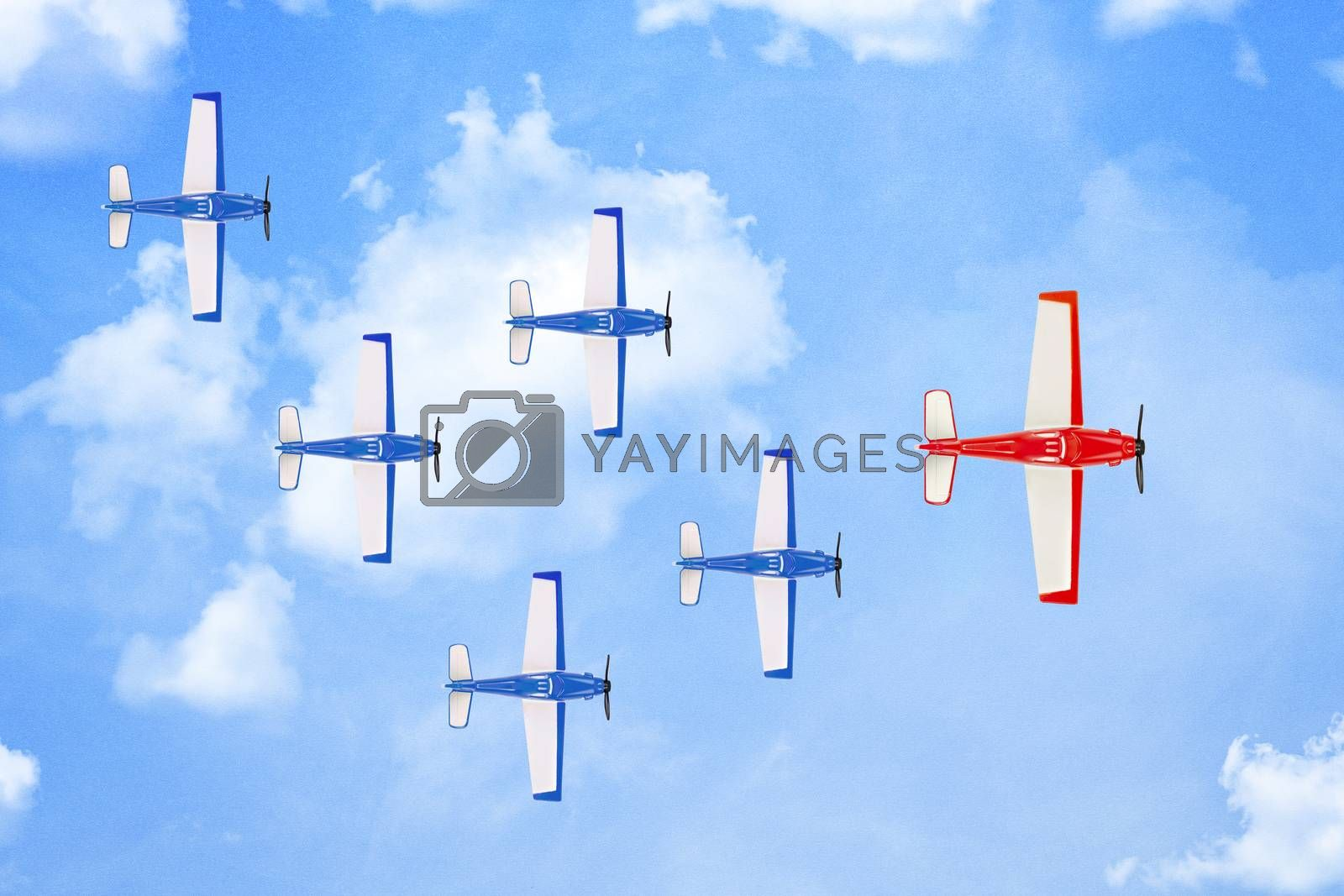 red plane leading a formation of smaller planes on paper surface with clouds, leadership concept