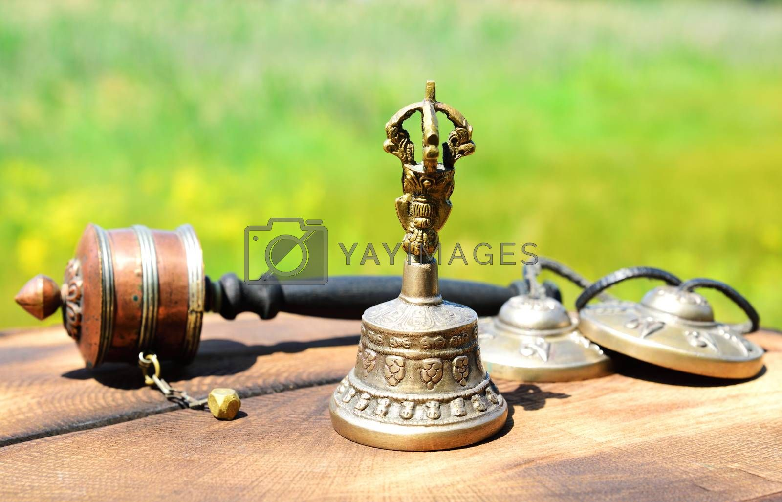 copper bell with Tibetan religious objects, close up by ndanko