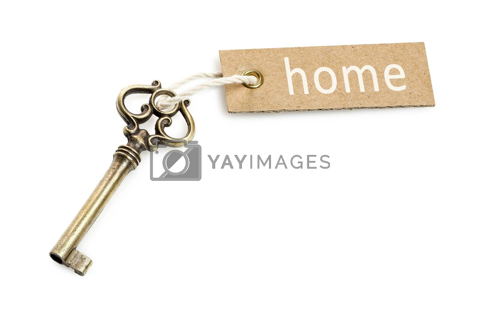 antique key with tag isolated on white, home concept