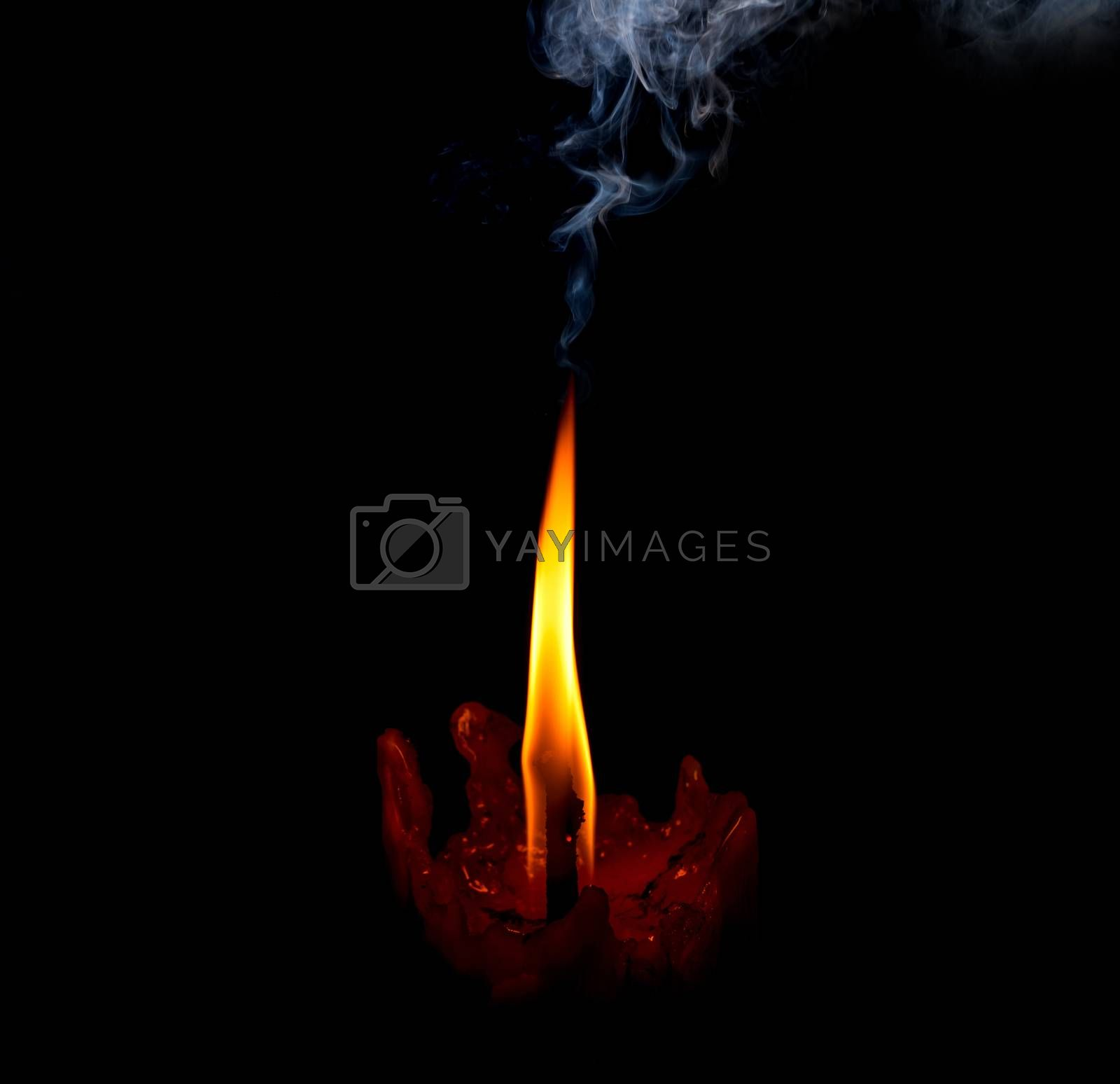 light flame candle burning brightly on black background by Chicha