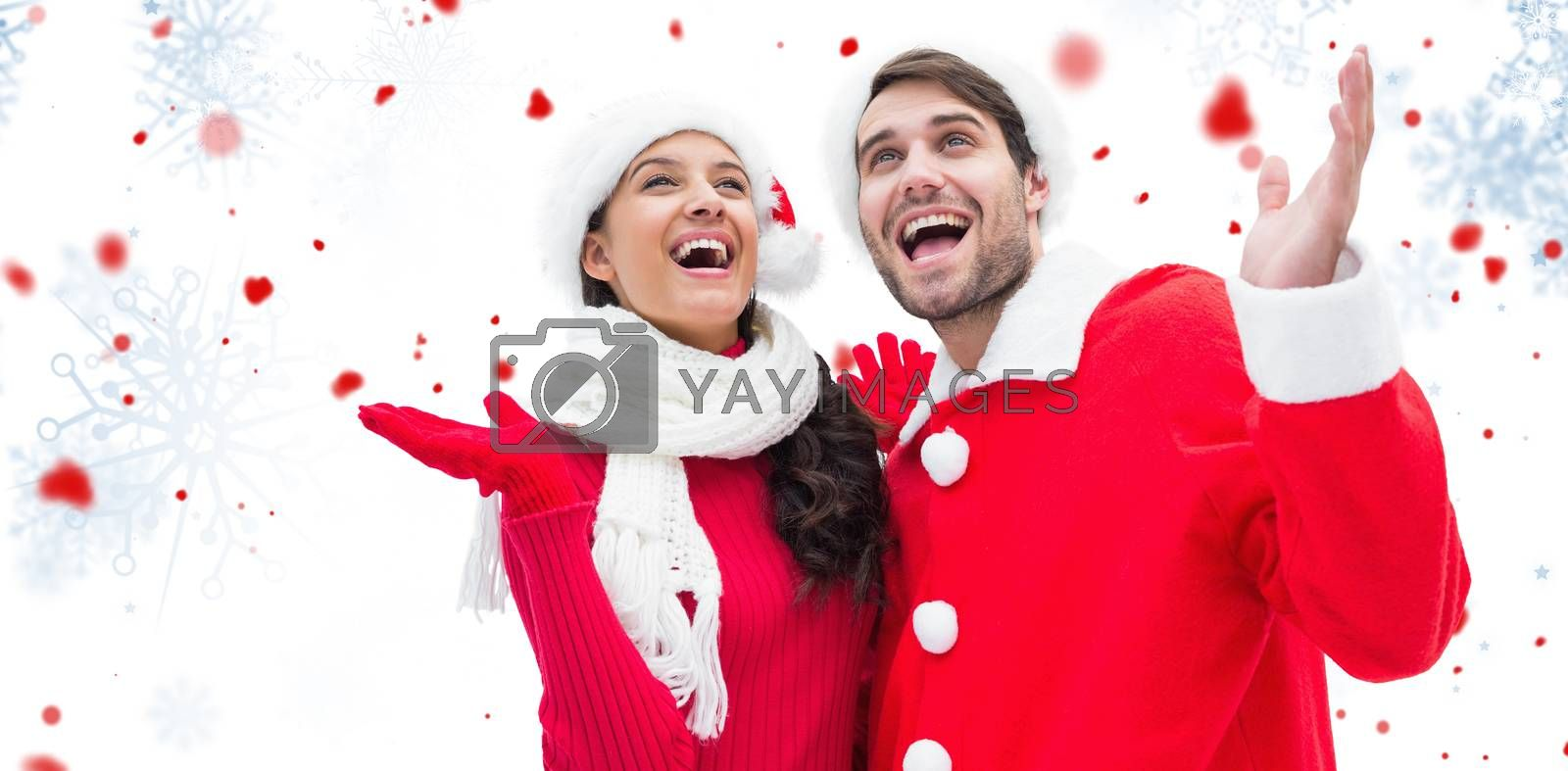 Festive young couple against snowflake pattern