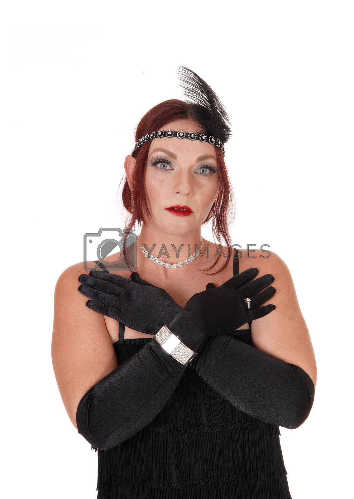 A gorgeous woman wearing a 20 century black dress with the head band and black cloves, isolated for white background