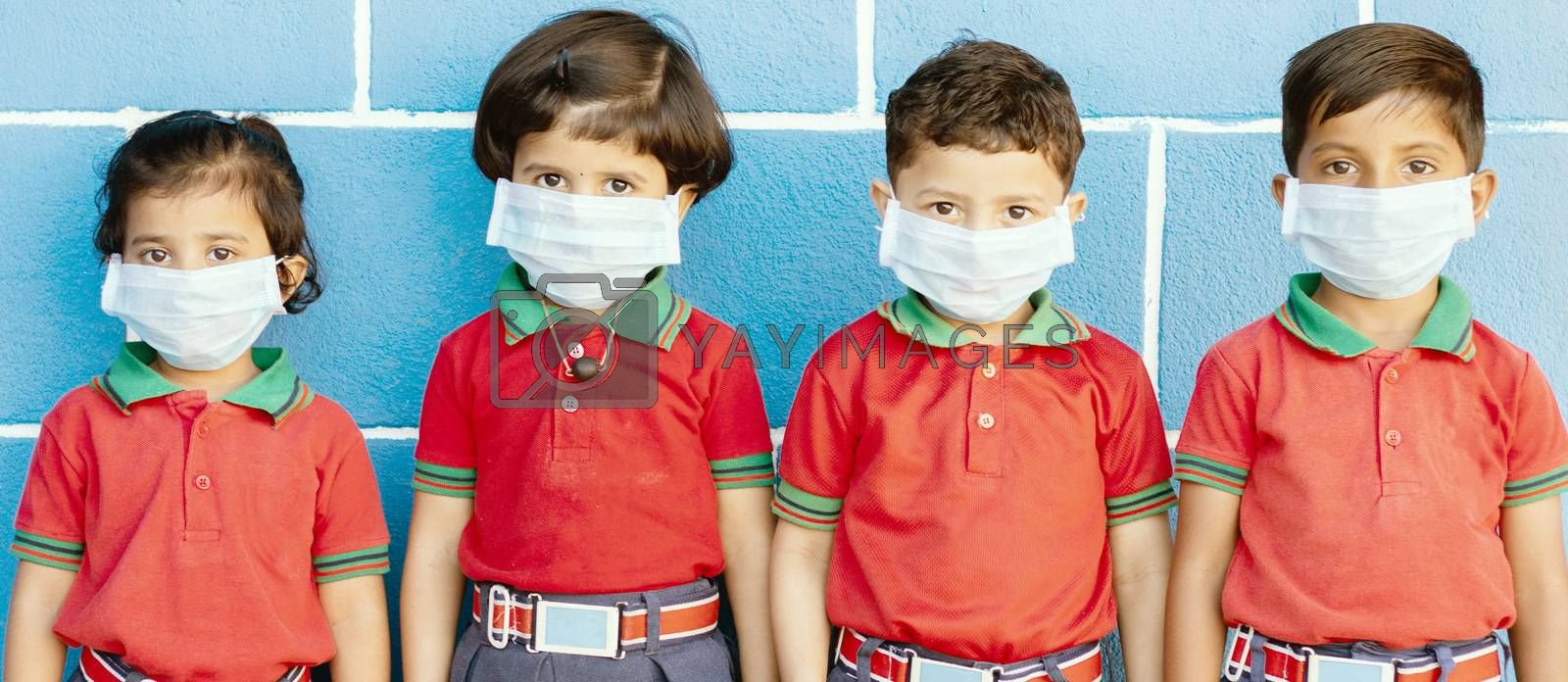 School preteen kids with protection face mask against new coronavirus, covid -19, nCov 2019 or sars cov 2 virus at school - children wore medical mask due to coronavirus outbreak. by lakshmiprasad