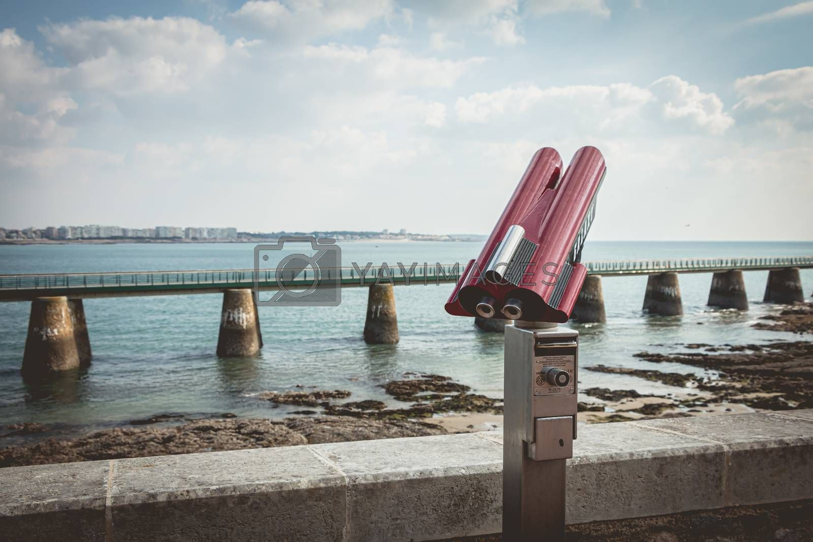 Sables d Olonne, France - October 13, 2015 : binocular telescope for tourist pointed to the beach on a fall day