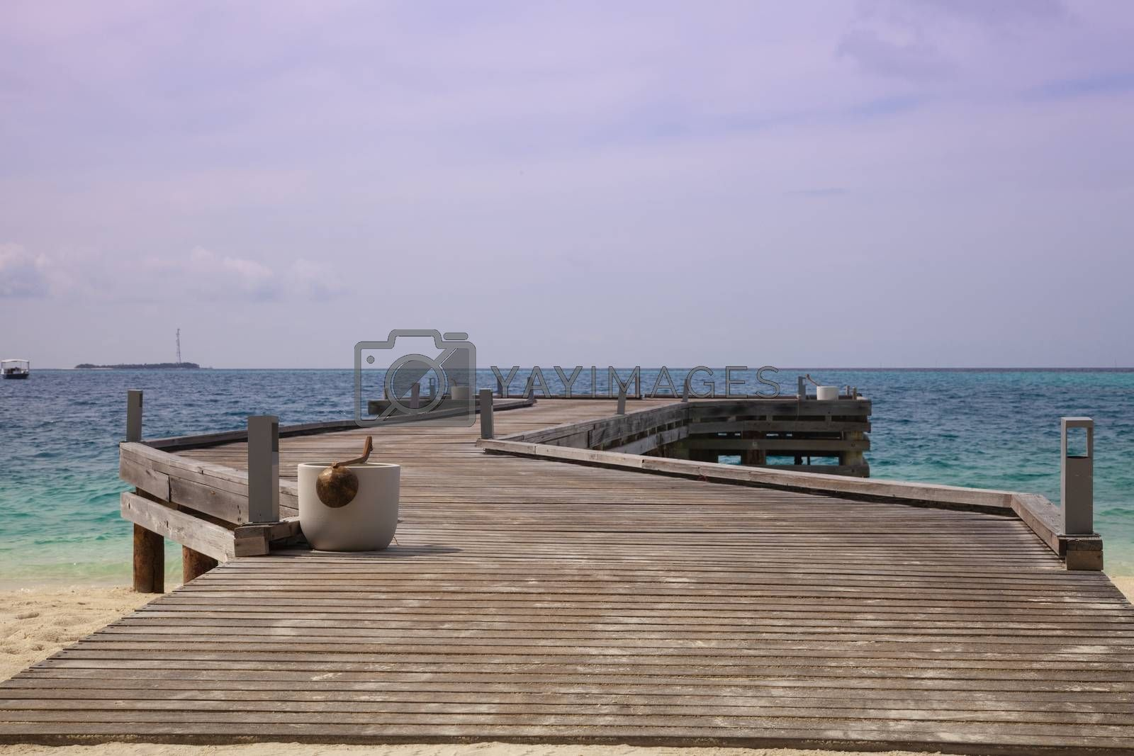 wooden bridge in the Maldives, goes out to sea by maselkoo99