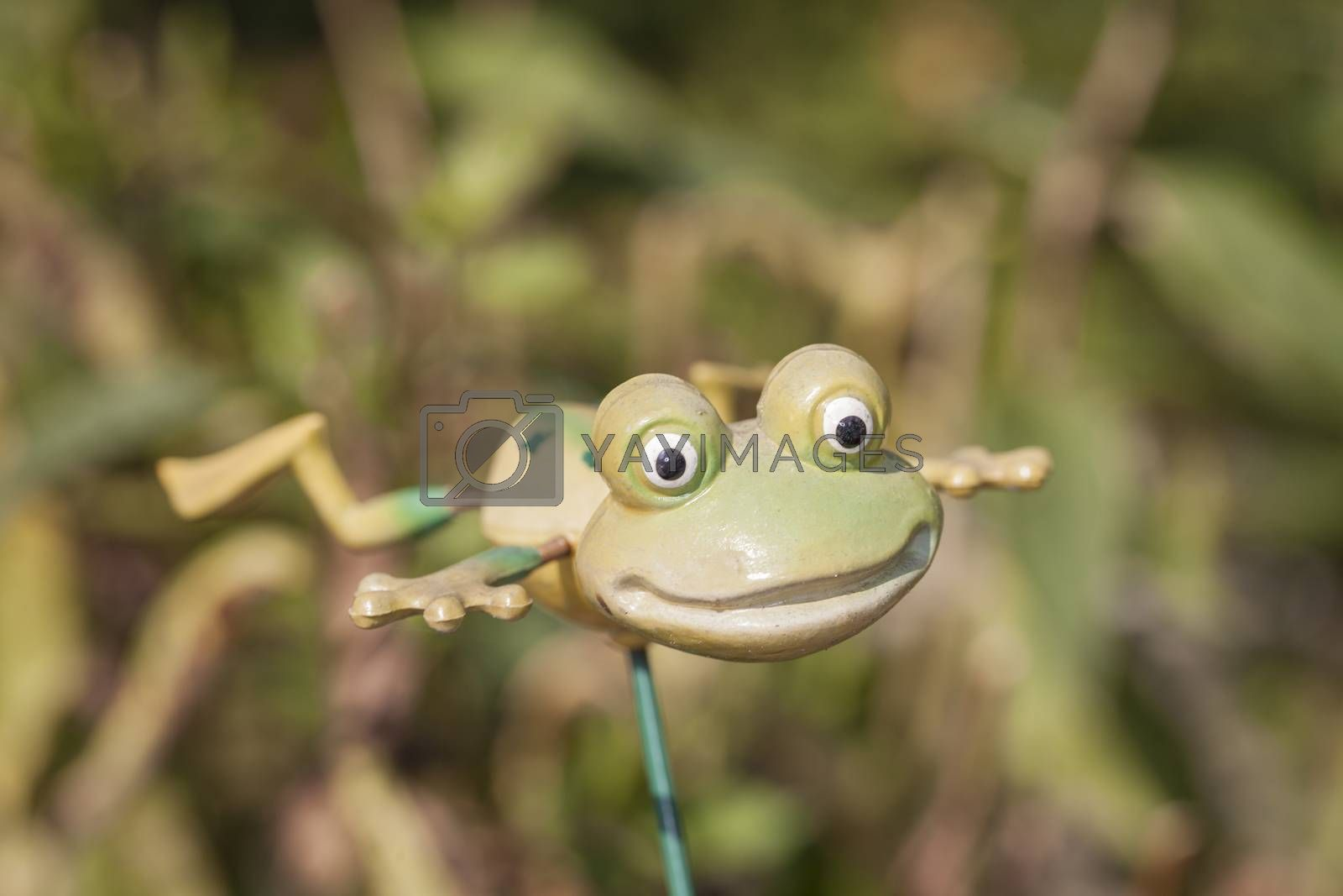 artificial frog on a stick, garden decoration