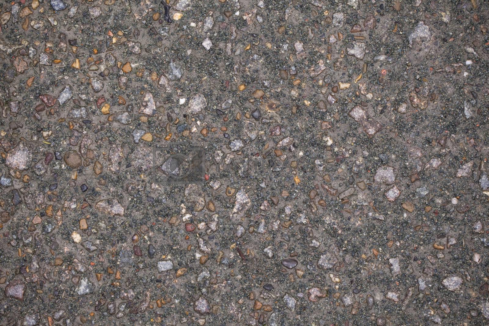 small pebbles in concrete, background, closeup