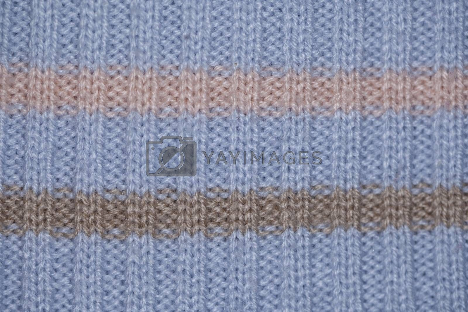 blue fabric textile background close up, brown and pink colour