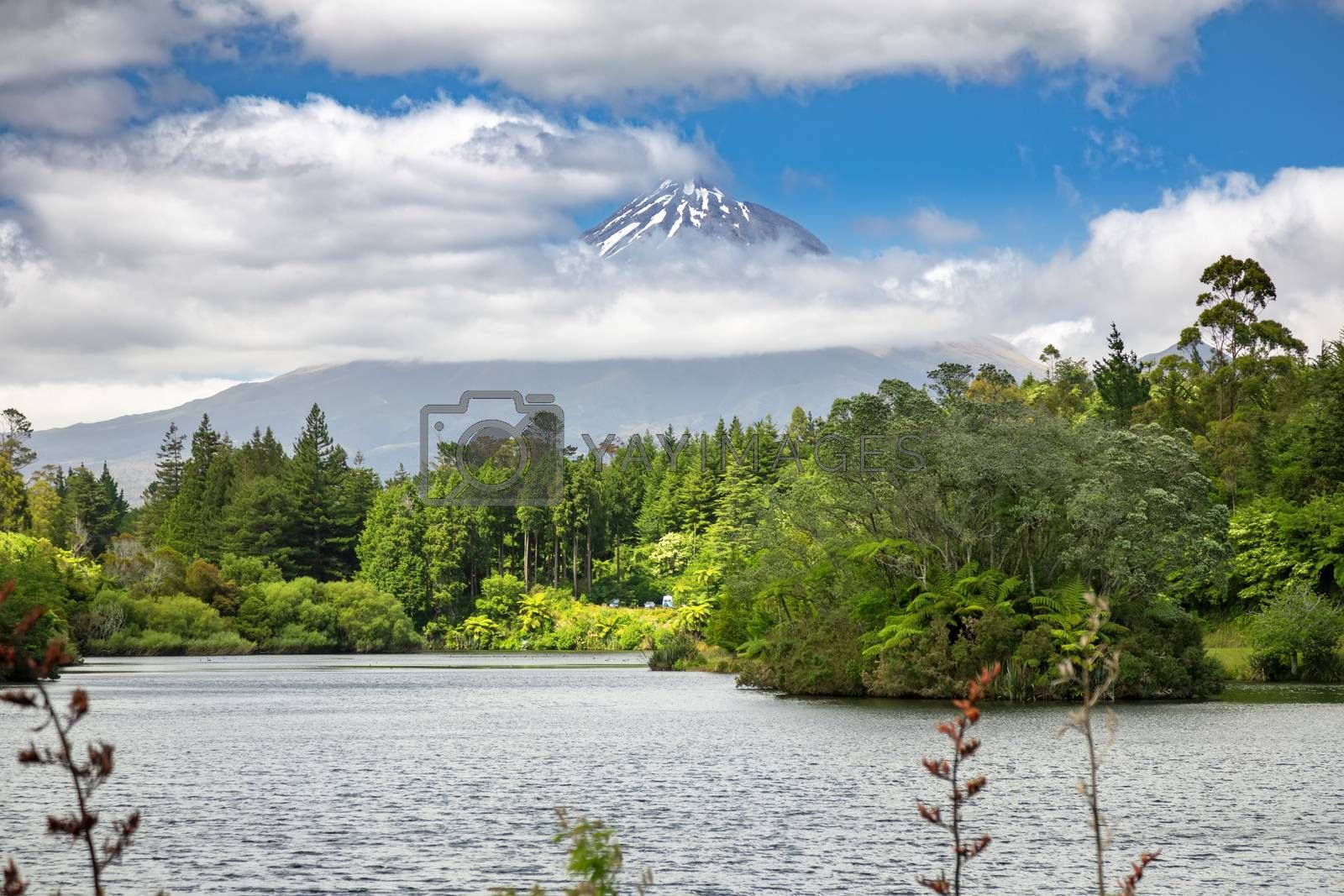 An image of the volcano Taranaki covered in clouds, New Zealand