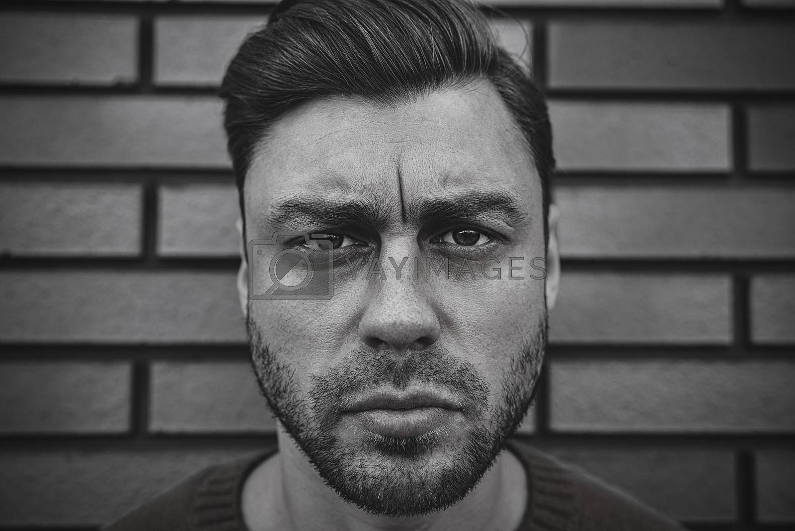 Portrait of a caucasian handsome man that is seriously frowning. Emotional face concept.