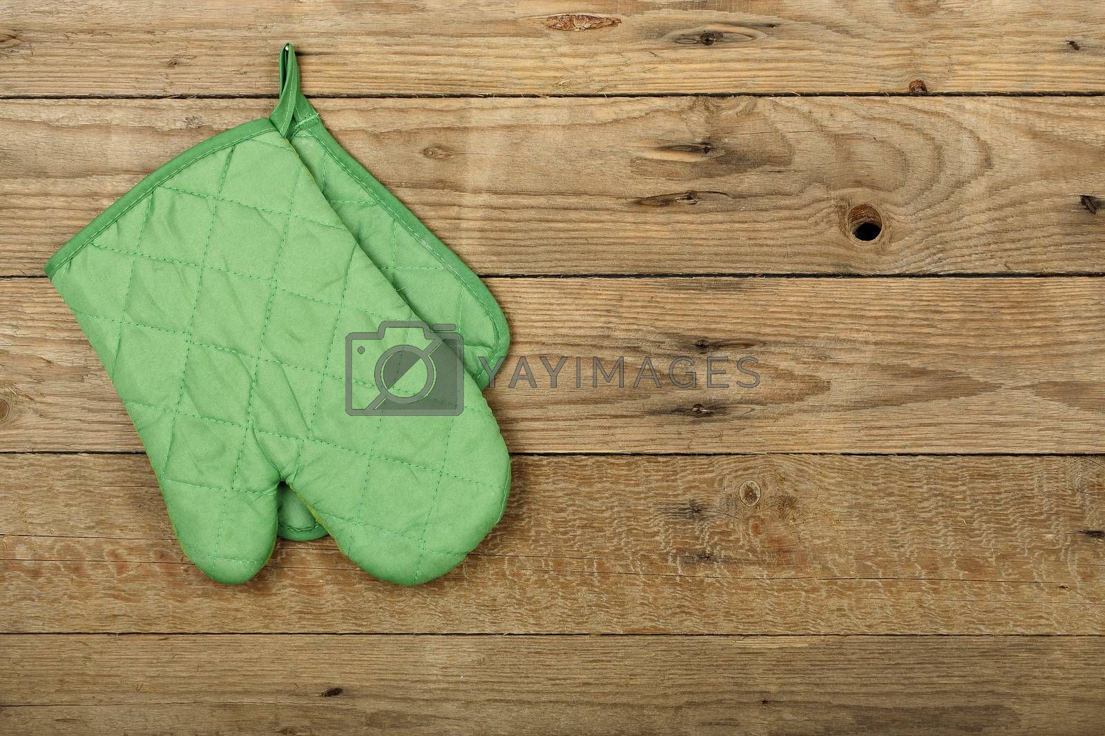 kitchen glove hung on old wooden surface