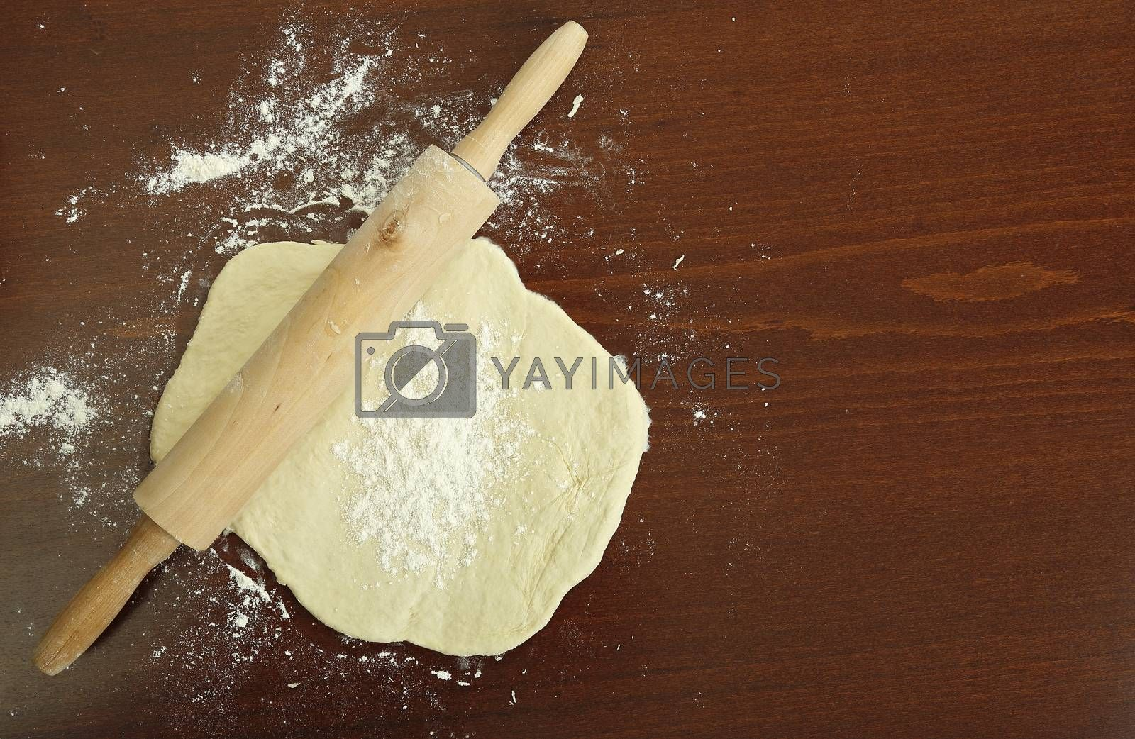 top view of rolling pin on dough