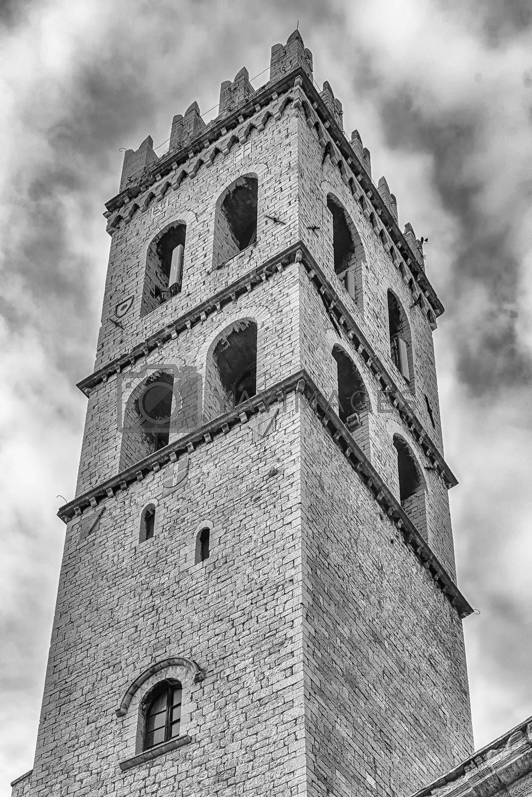 Ancient stone belltower of the Temple of Minerva, iconic landmark in Assisi, Italy