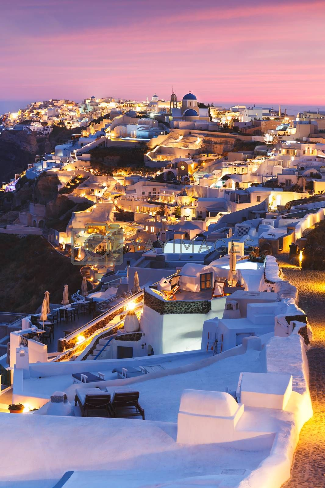Unique view for the sunset over Oia, Santorini, a small, beautiful village on the edge of the caldera, Greece
