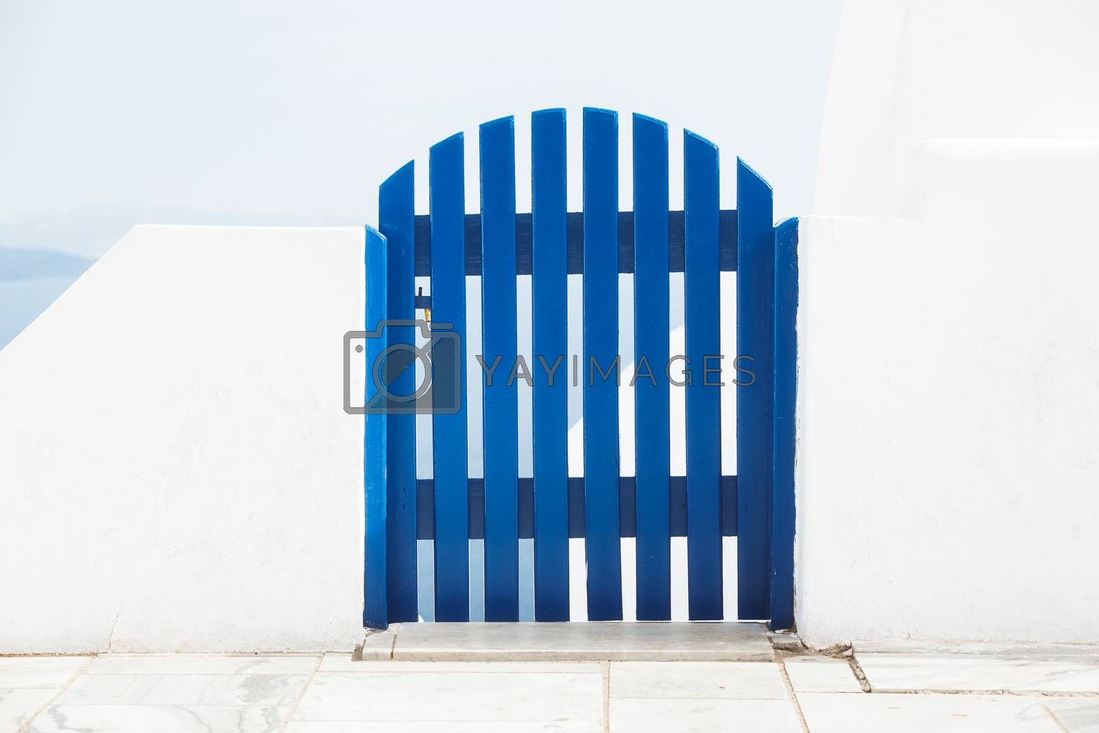 Blue wooden gate in front of the sea,Greece, Santorini, Oia,