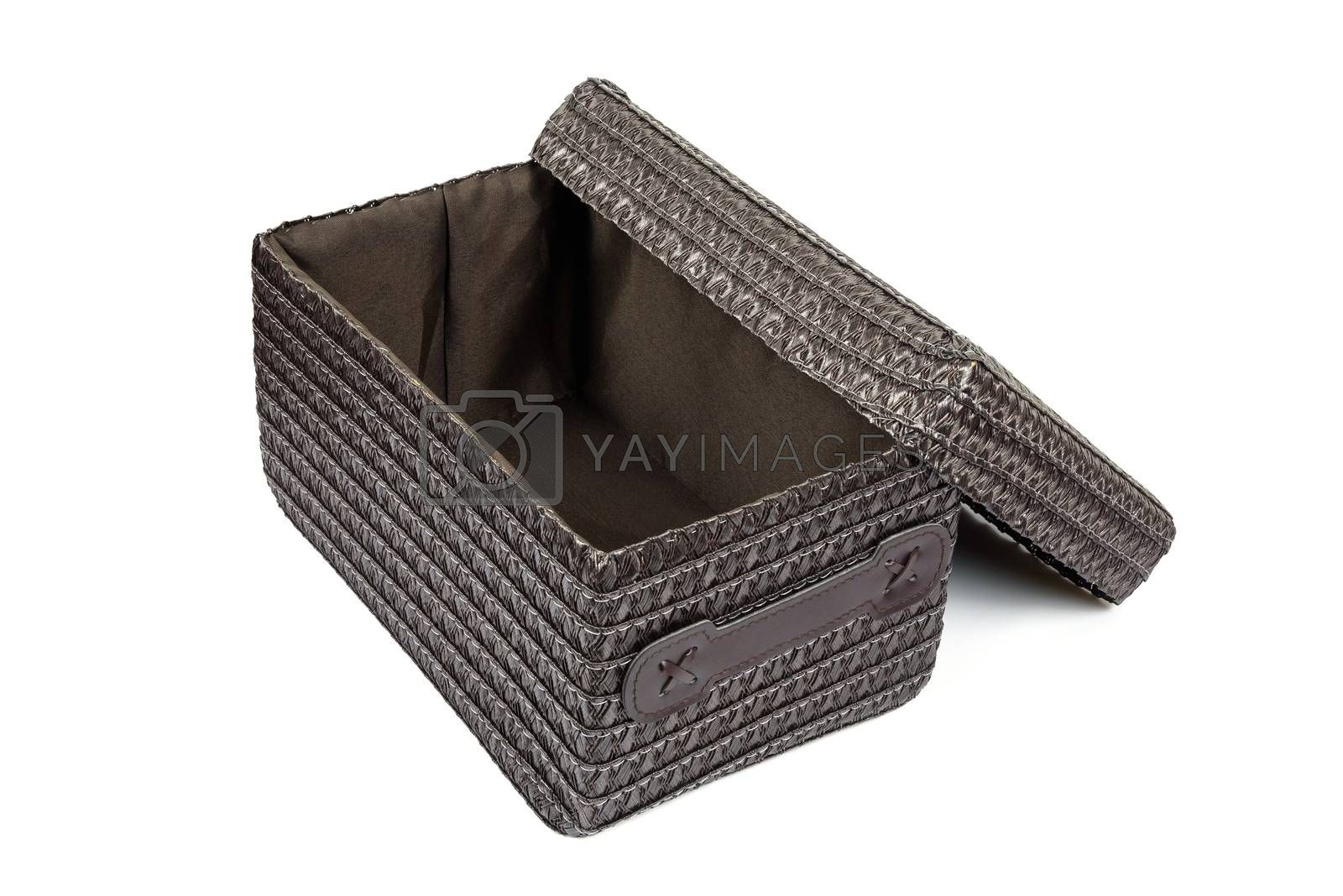 Open brown wicker box isolated on white background with clipping path