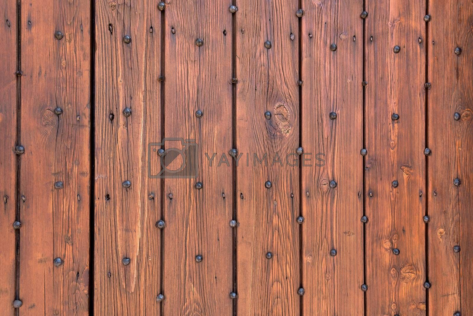 Background or texture made of wooden planks with nails