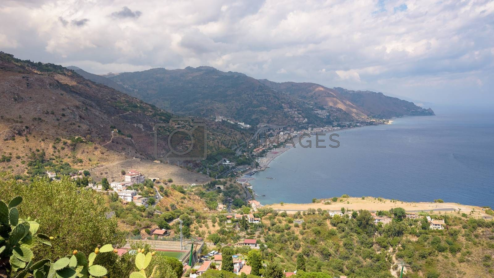 Panoramic view of Sicilian coast with Letojanni town from Taormina, Italy