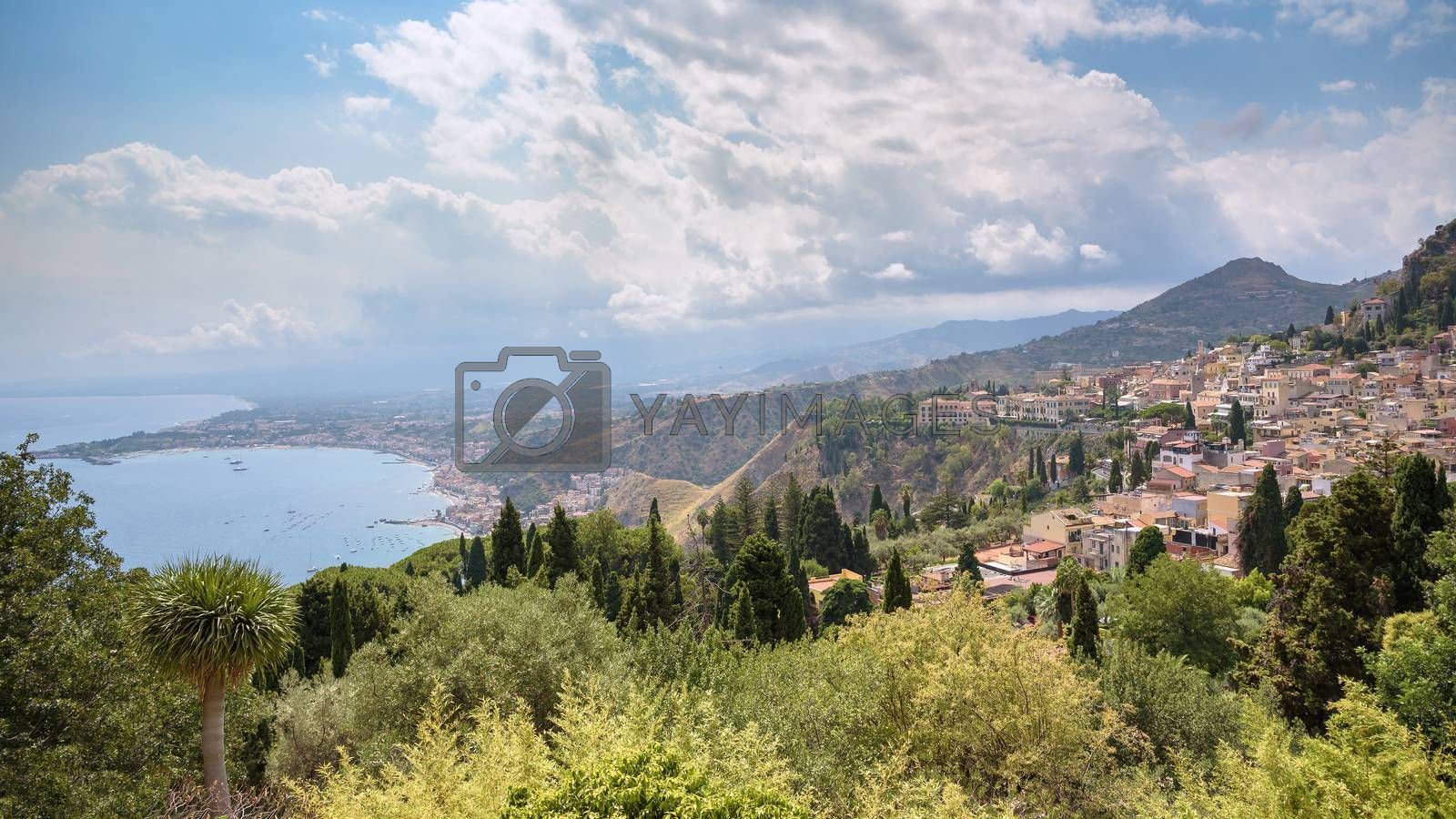 Panoramic view of Taormina with Giardini Naxox town in the backgroind, Sicily, Italy