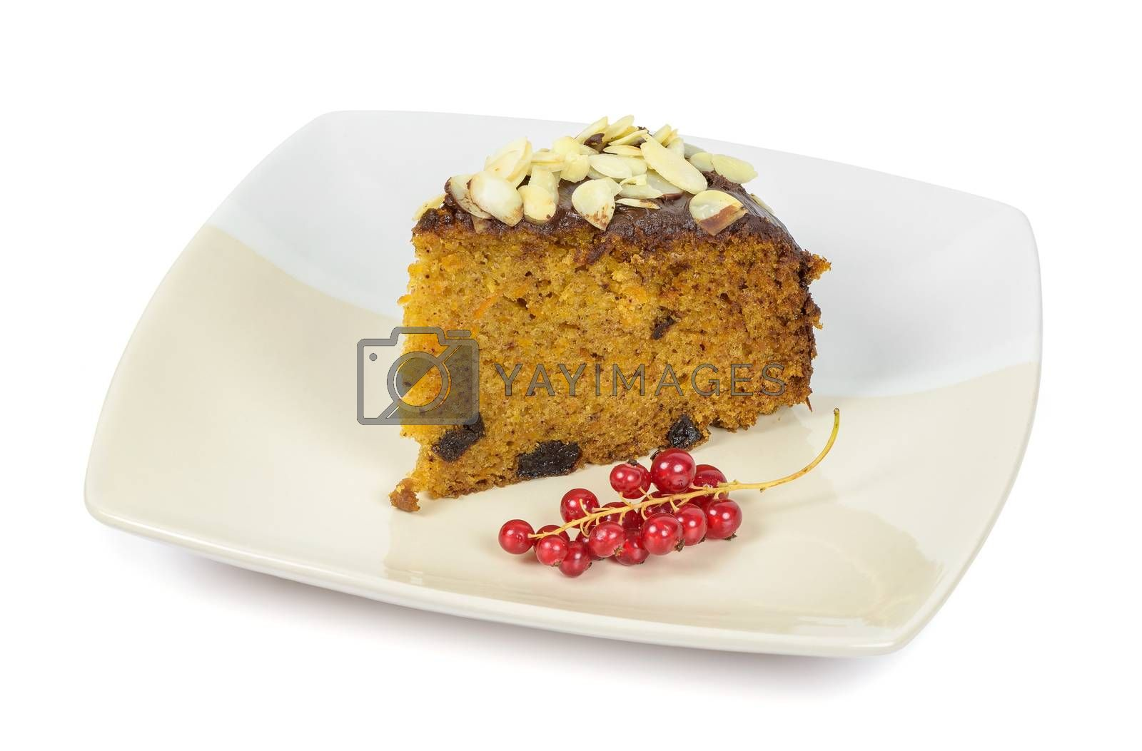 Carrot cake with almond flakes and red currant on a plate isolated on white background with clipping path