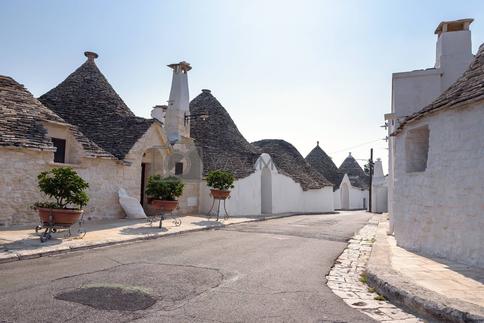 View of street in Alberobello town with famous trulli houses, Italy