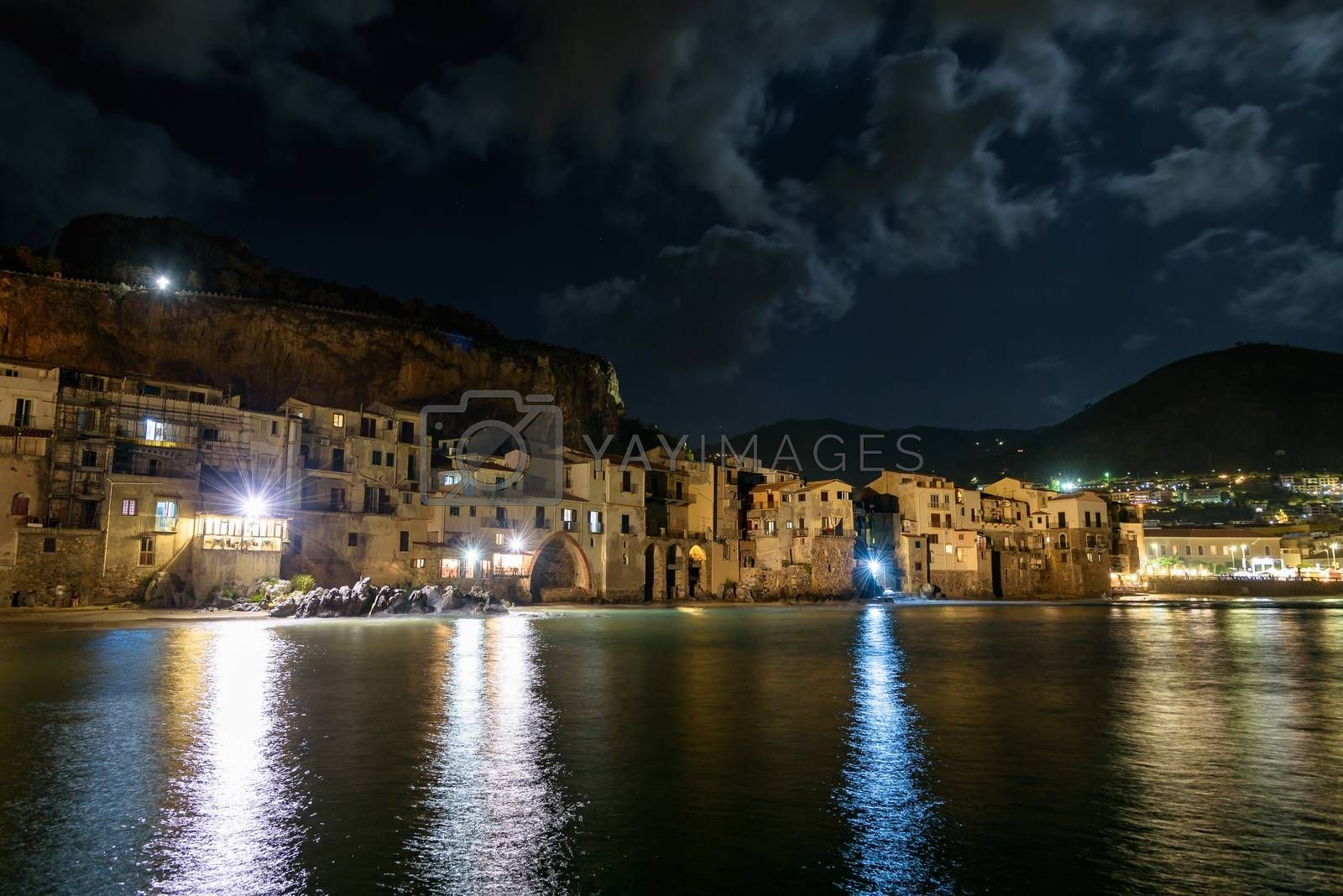 View of coast in Cefalu town on Sicily by night, Italy