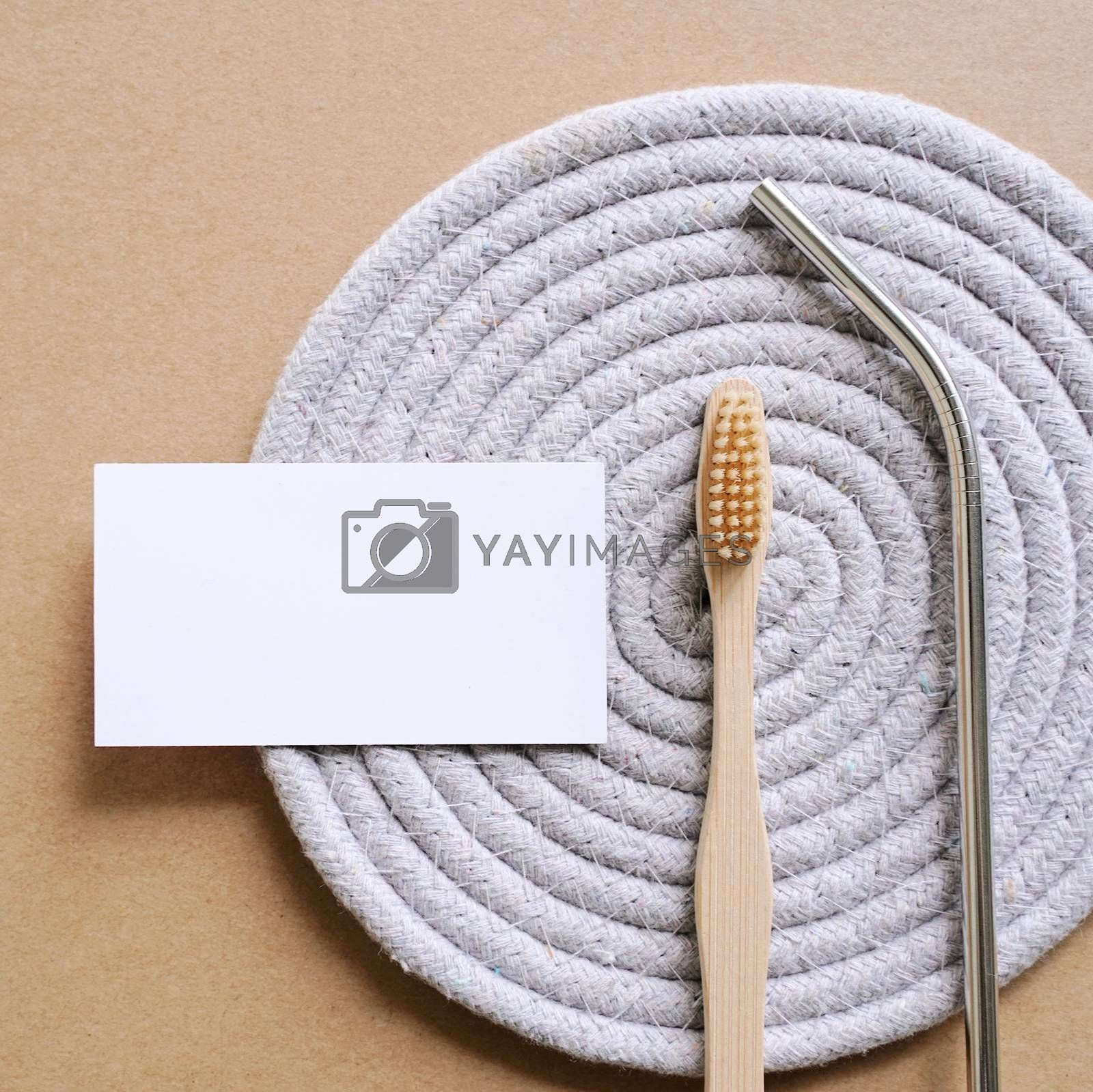 Flat lay branding identity business name card of sustainable products, stainless straw and bamboo toothbrush, minimal style