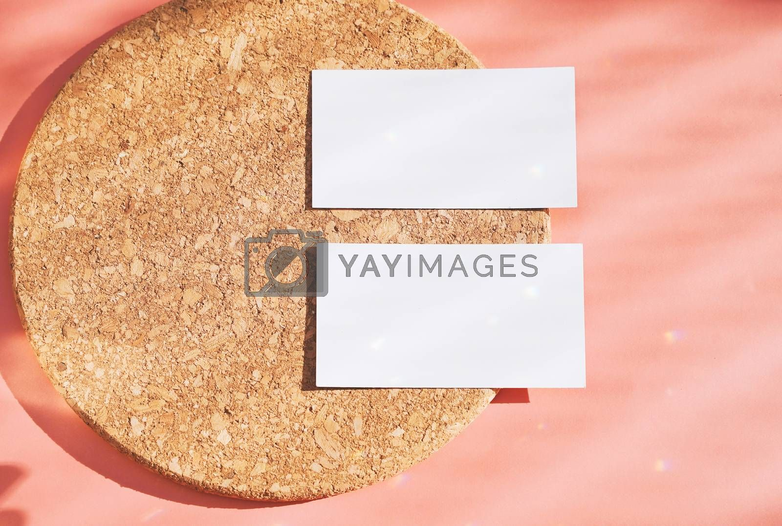 Flat lay of branding identity business name card on wood board and orange background, light and shadow shape with sparkle effect, minimal design