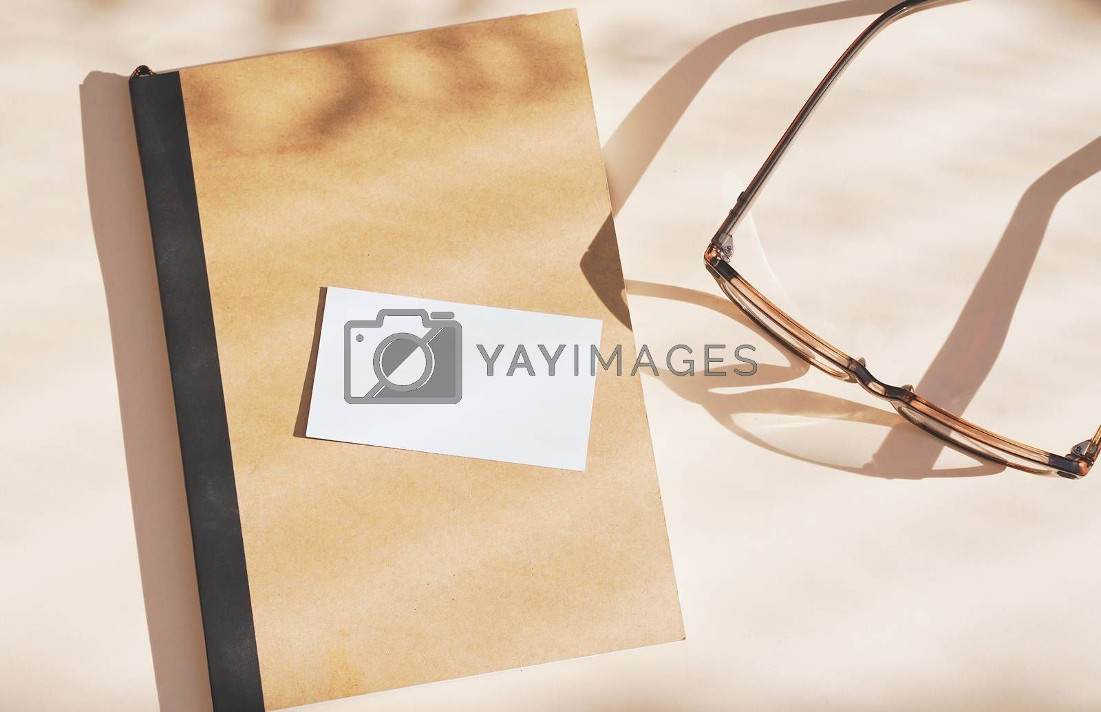 Royalty free image of Flat lay of branding identity business name card on notebook wit by nuchylee