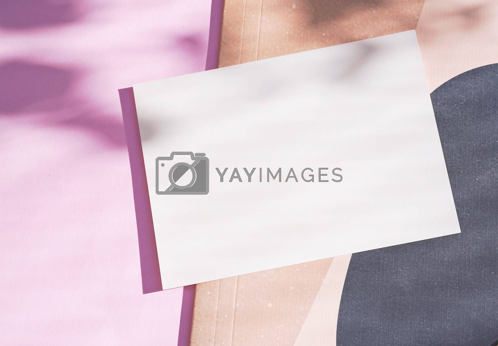 Royalty free image of Flat lay of branding identity blank postcard on pink background  by nuchylee