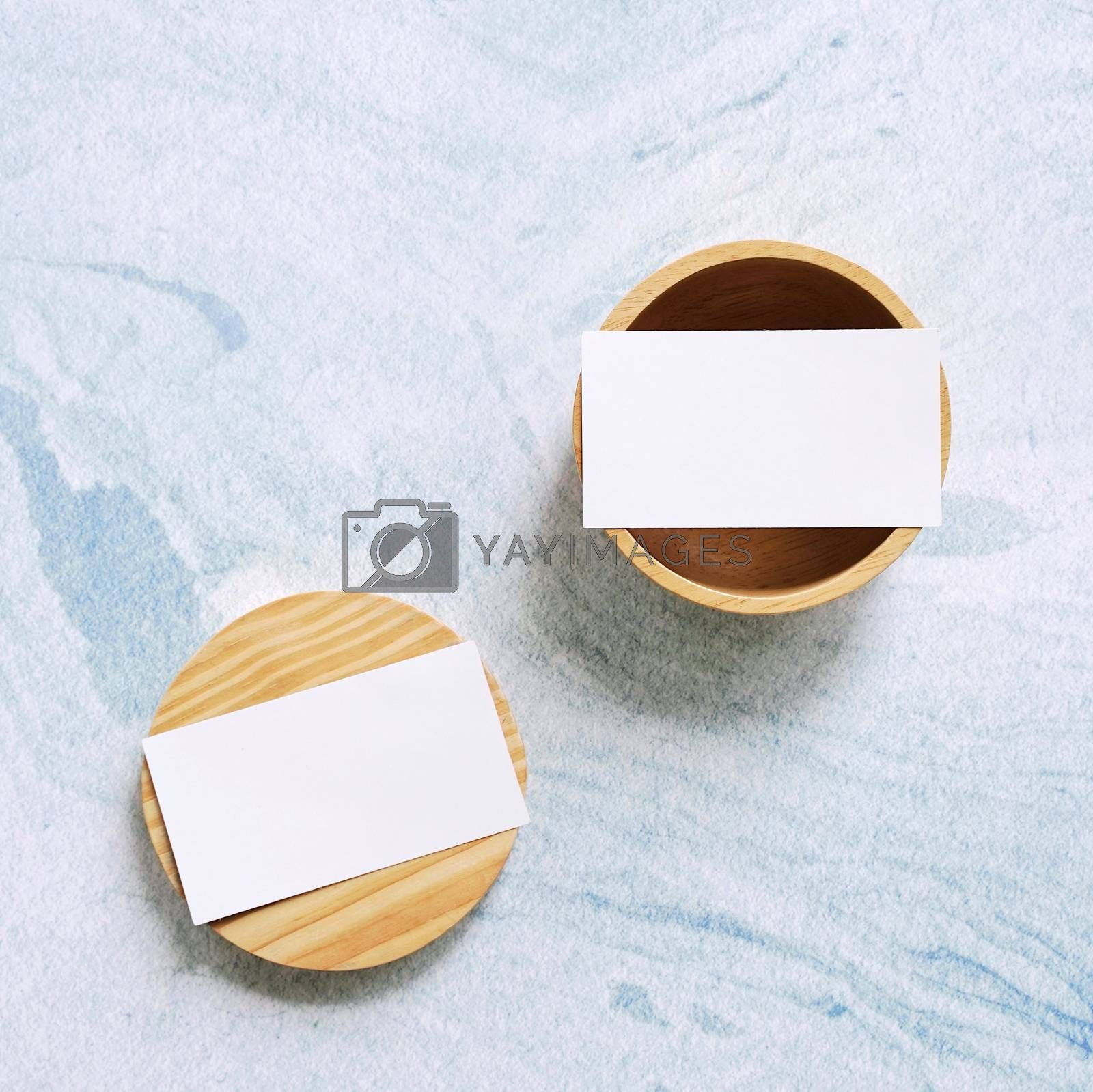 Royalty free image of Flat lay branding identity business name card on wooden containe by nuchylee