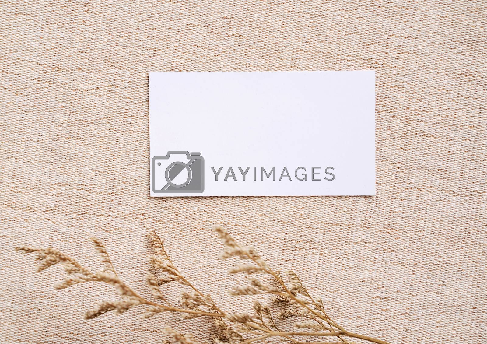 Royalty free image of Flat lay of branding identity business name card on brown fabric by nuchylee
