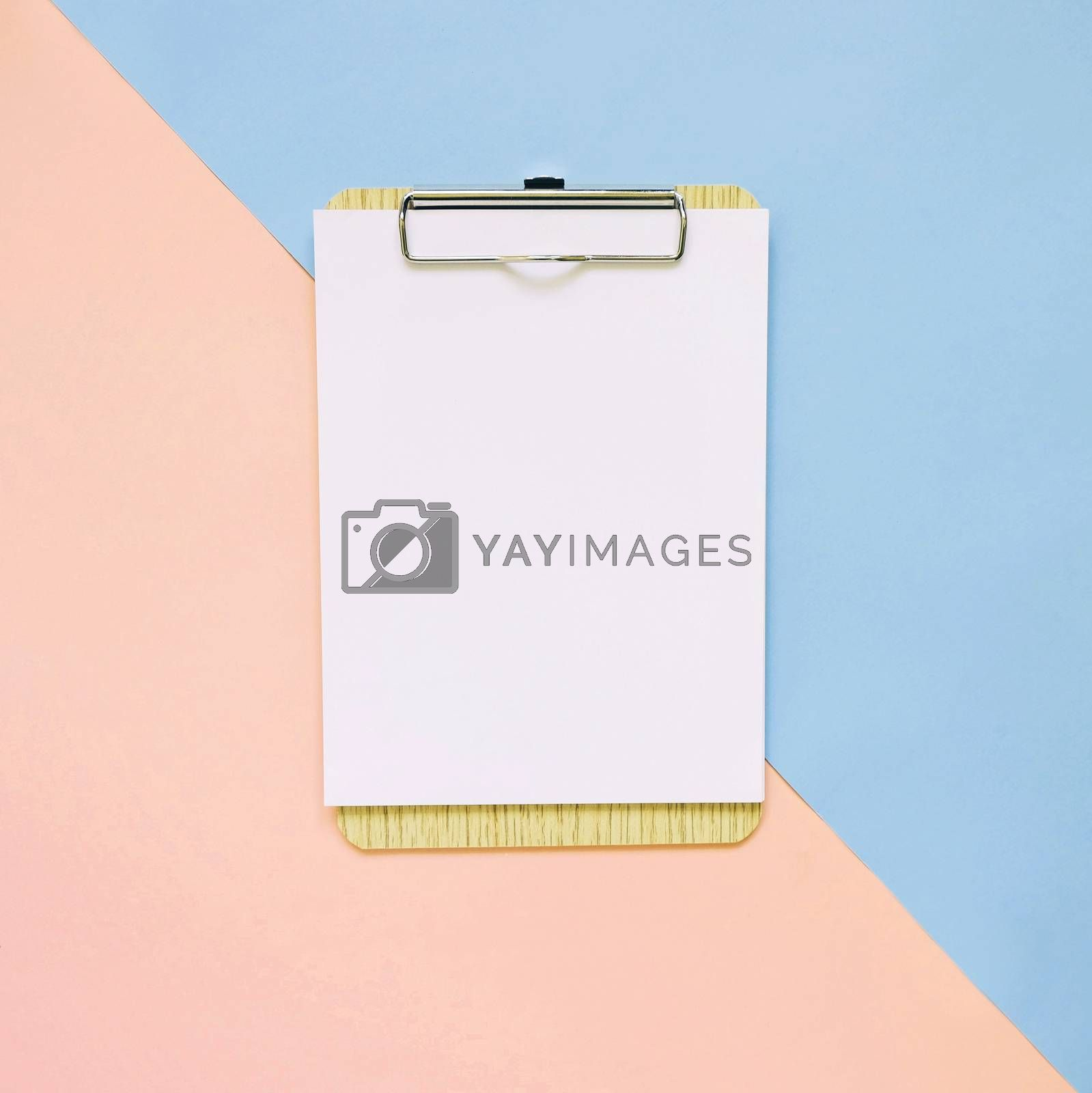 Royalty free image of Blank clipboard on pastel color background, minimal style  by nuchylee
