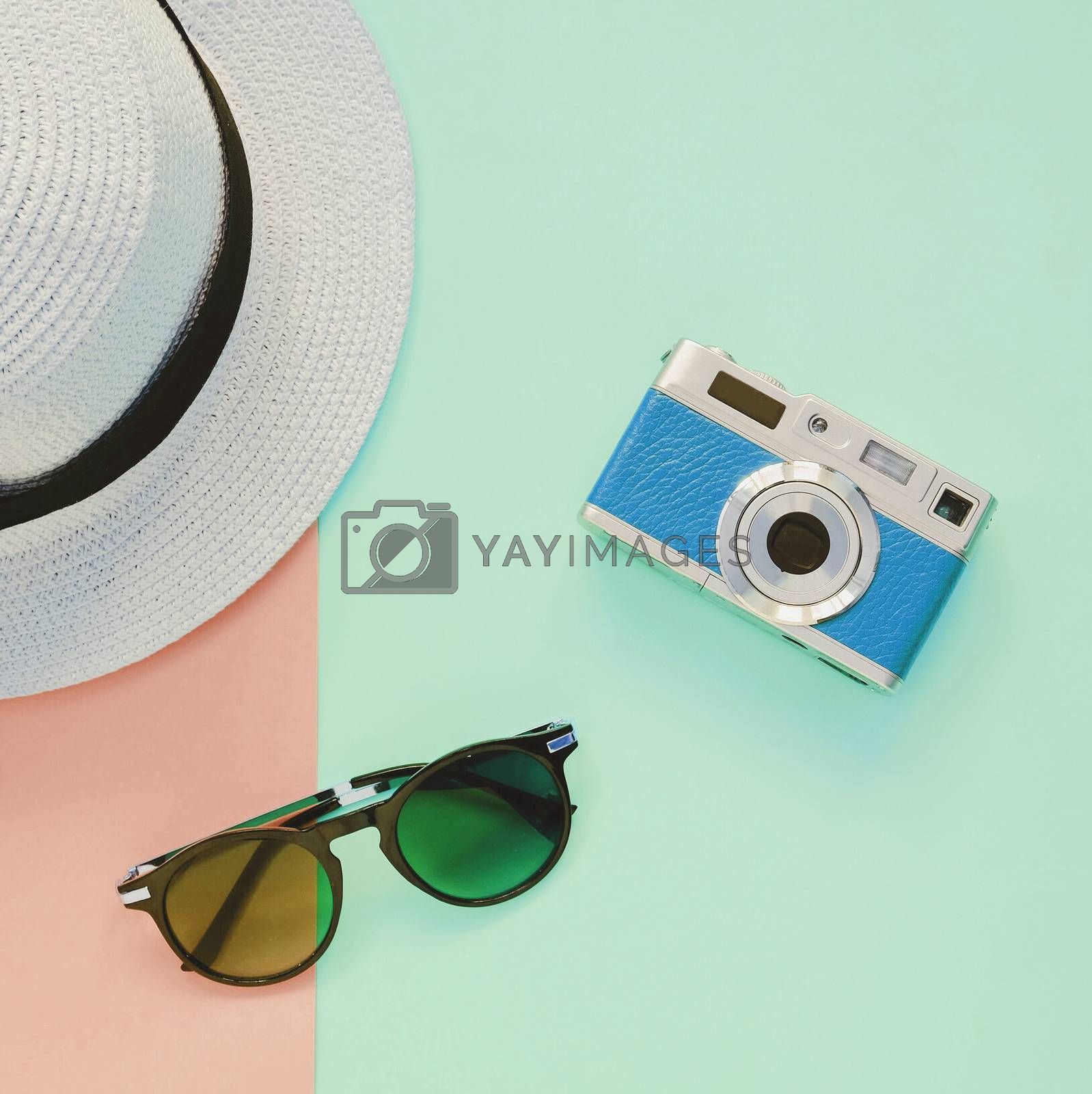 Royalty free image of Creative Flat lay fashion style with camera, sunglasses and pana by nuchylee