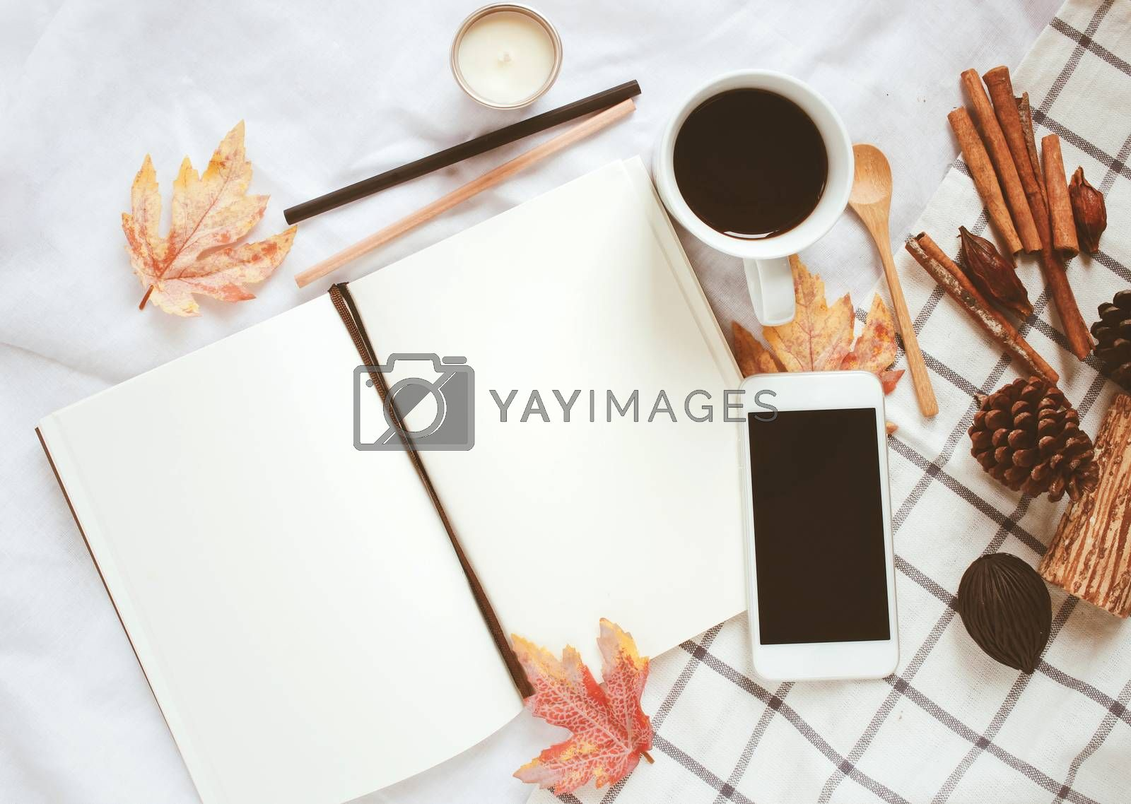 Royalty free image of Autumn lifestyle concept, blank notebook, smartphone and coffee  by nuchylee