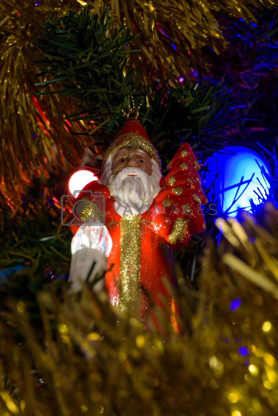 Closeup of Santa Claus figure on a Christmas tree as background
