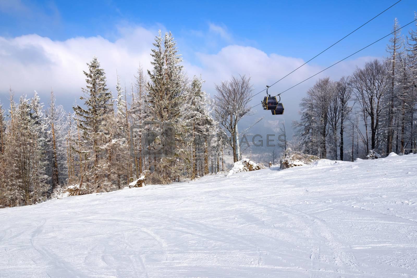 Gondola lift over the ski slope in Szczyrk, Beskid Mountains, Poland