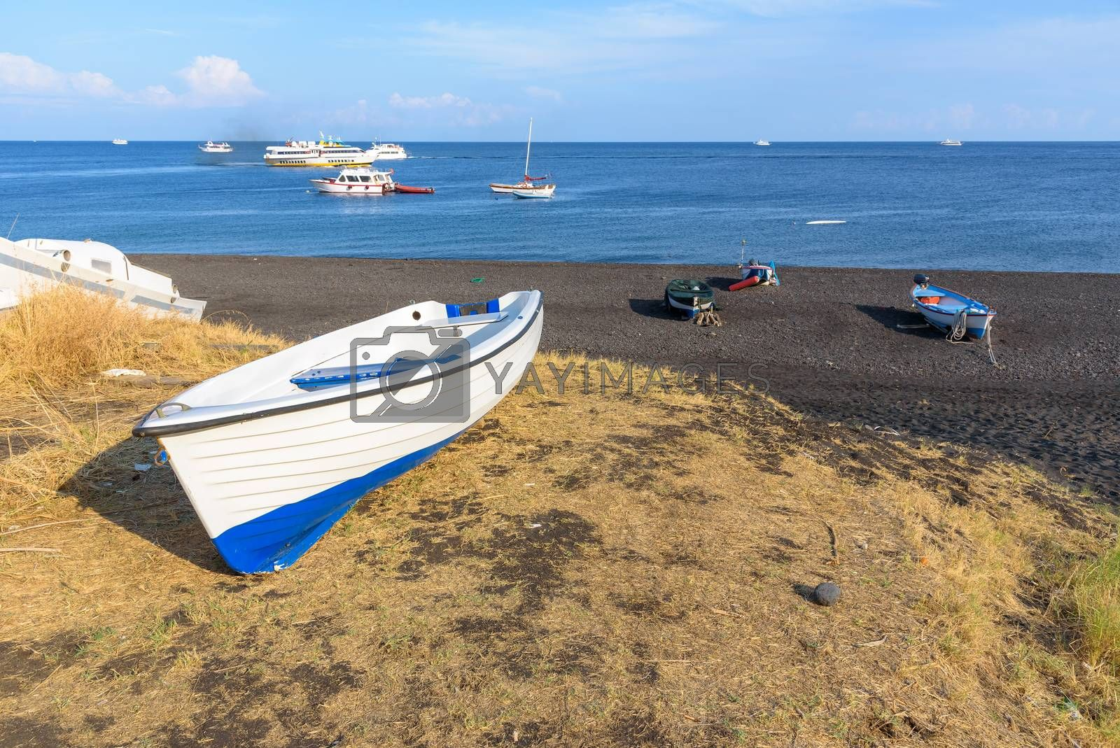Boat on the black volcanic beach on Stromboli Island, Aeolian Islands, Italy