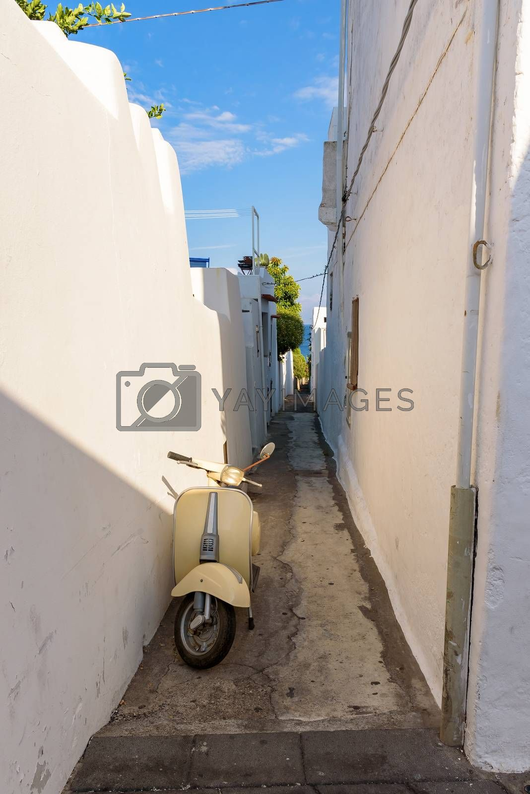 Scooter in narrow street of Stromboli village, Aeolian Islands, Italy