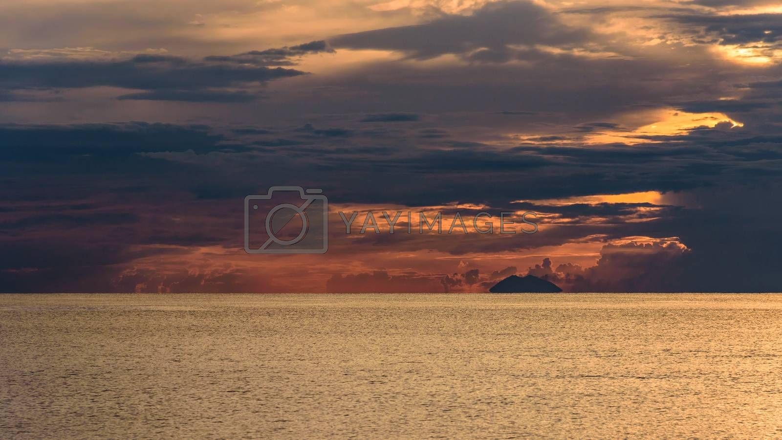 Dark clouds at sunset on the Tyrrhenian Sea with Stromboli vulcano in the background